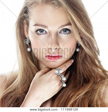 Beautiful woman with pearl jewellery