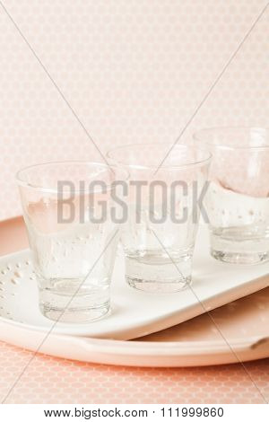 Three Cocktail Glasses on a pink set