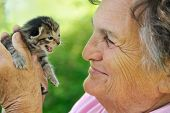 An image of senior woman holding kitten - detail poster