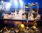 New Year in Budapest - Champagne glasses and Budapest parliament with fireworks in the background poster