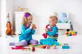 Children with music instruments. Musical education for kids. Colorful wooden art toys. Little girl and boy play music. Kid with xylophone guitar flute violin. Early development for toddler and baby poster