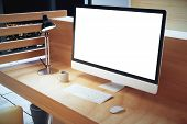 Blank white computer screen with lamp on wooden table at hight mock up poster