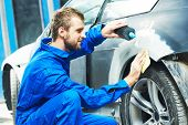 auto mechanic worker applying washing car body preparing for painting at automobile repair and renew service station poster