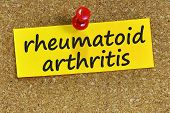 rheumatoid arthritis word on yellow notepaper with cork background. poster