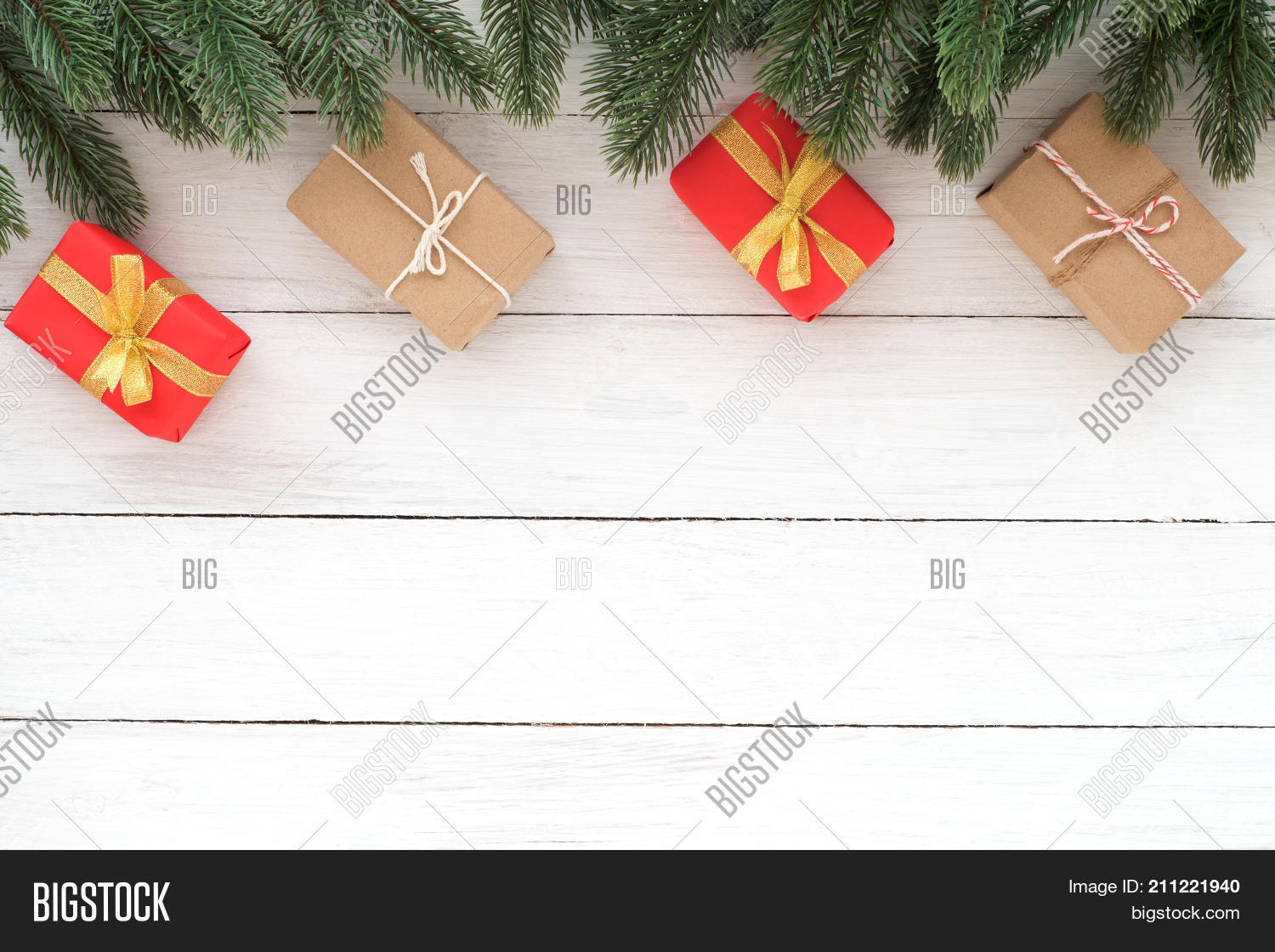 christmas and new year background christmas present gift boxes and fir leaves with decoration rustic