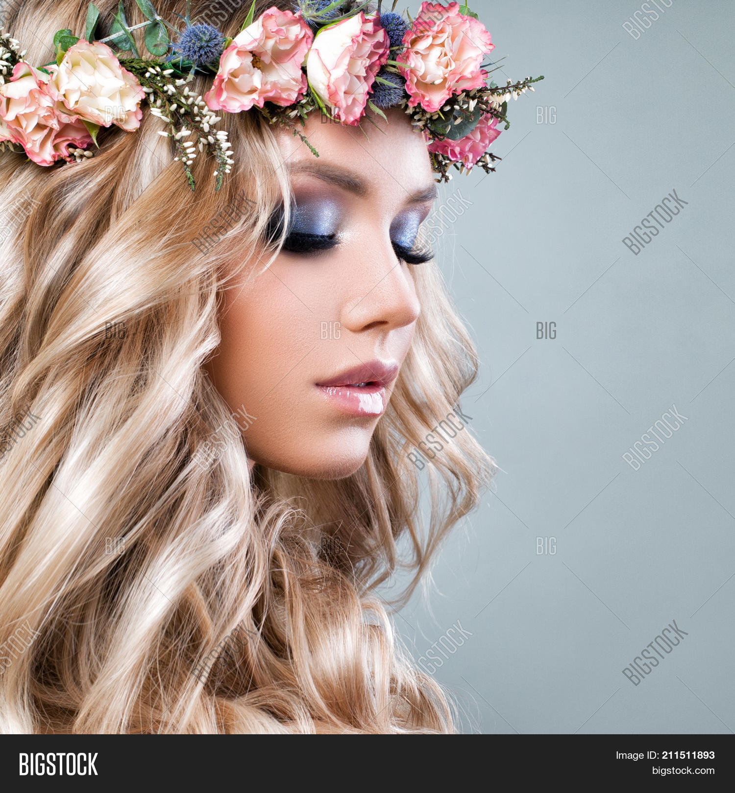 Beautiful woman summer image photo free trial bigstock beautiful woman with summer pink flowers blonde beauty long permed curly hair and fashion izmirmasajfo