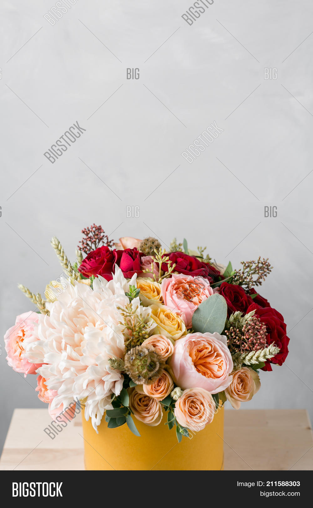 Flowers round luxury image photo free trial bigstock flowers in round luxury present box bouquet of mixed flowers in yelow paper box izmirmasajfo