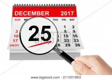 Christmas Day Concept. 25 December 2017 calendar with magnifier on a white background