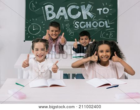Multiethnic Schoolkids With Thumbs Up