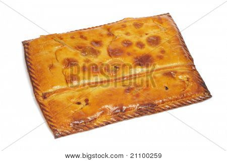closeup of an empanada gallega, a typical cake stuffed with tuna or meat, from Galicia, Spain