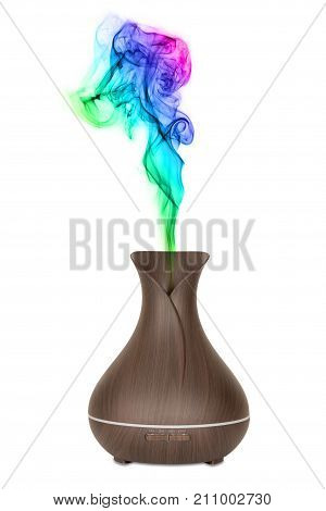 Aromatherapy Concept. Wooden Electric Ultrasonic Essential Oil Aroma Diffuser and Humidifier with Colour Steam on a white background