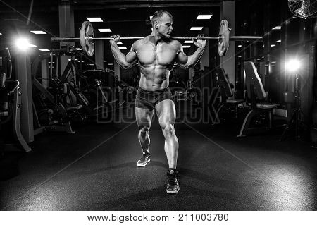 Handsome Model Young Man Training Legs In Gym