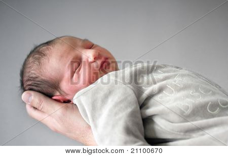 Newborn Sleeping on Dad's Hand