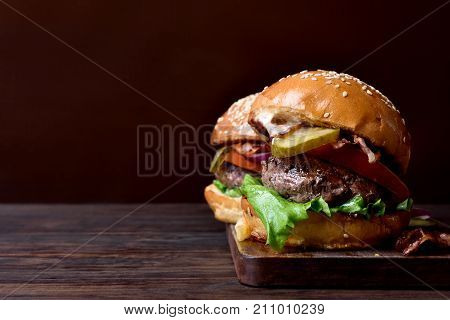 Burger On Wooden Background With Copy Space