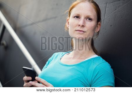 Sportswoman With Mobile Phone