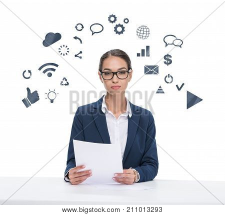 Newscaster With Papers Looking At Camera