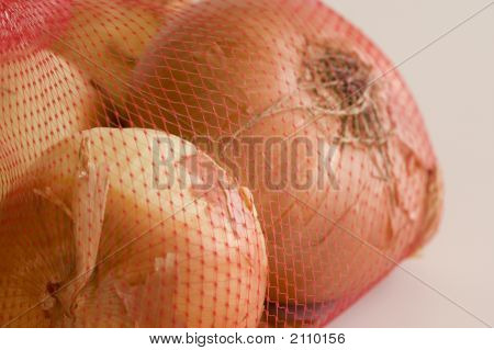 Yellow Onions In A Net Bag