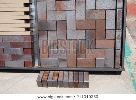 Pavement bricks for paving for sale. Building and construction materials colored concrete pavers (paving stone) patio blocks