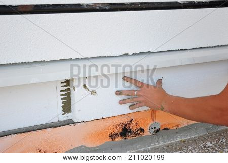 House foundation insulation with styrofoam thermal insulation board.