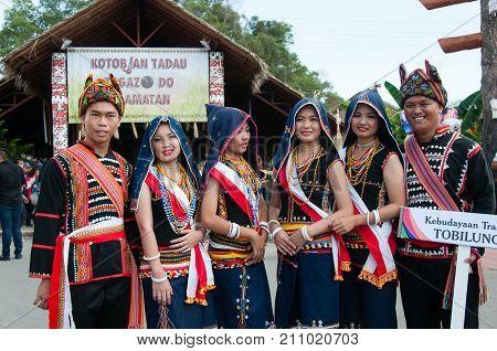 Kota Kinabalu, Malaysia - May 30, 2015: Group Portrait Of Kadazandusun Tobilung Tribe In Their Tradi