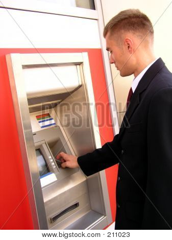Businessman Using Cash Machine