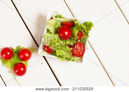 Small Bowl Of Lettuce And Tomato Salad