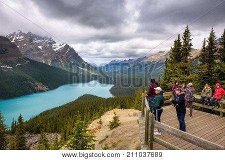 PEYTO LAKE, ALBERTA, CANADA - JUNE 28, 2017 : Tourists enjoy the scenic view of Peyto Lake in Banff National Park.