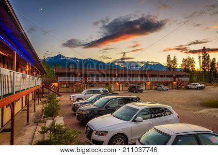 VALEMOUNT, CANADA - JUNE 29, 2017 : Summer sunset above canadian Rocky Mountains and the Rocky Inn in Valemount.
