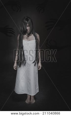 Mystical Ghost Woman With Long Black Hair And Shadow Hands On Dark