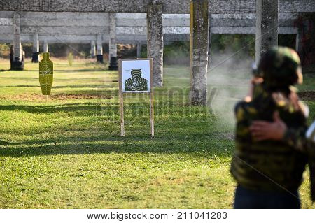 Outdoor shooting with a 9mm pistol in a shooting range