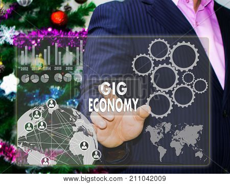 The Businessman Chooses Gig Economy On The Touch Screen, The Backdrop Of The Christmas Tree And Deco