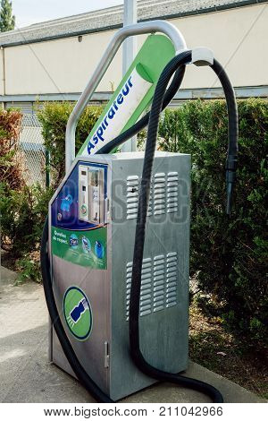STRASBOURG FRANCE - SEP 28 2014: Elephant Bleu car wash station vacuum cleaner device operated by coins and jetons