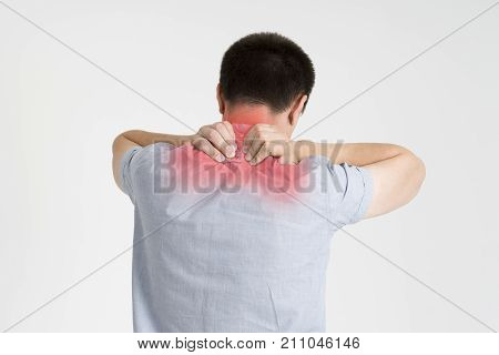Neck pain man with backache on gray background with red dots