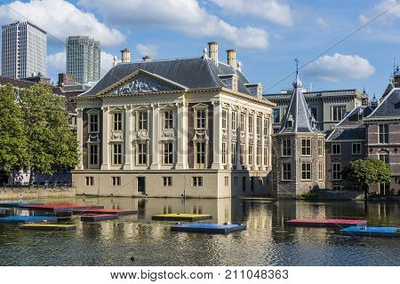 The Hague The Netherlands - August 6 2017: Museum 'Mauritshuis' and the 'Torentje' of prime minister of the Netherlands in front the pond 'the Hofvijver'.