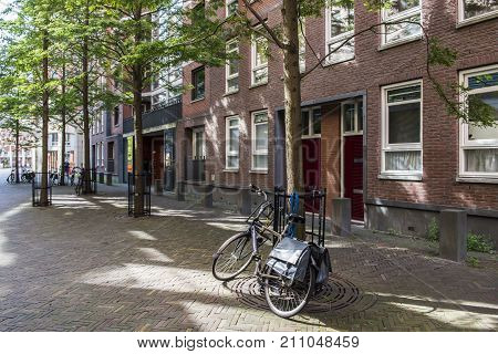 The Hague The Netherlands - August 6 2017: Bikes and houses in the Muzenstraat in The Hague.