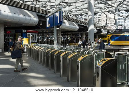 The Hague The Netherlands - August 6 2017: People at the central station The Hague at the OV check points and the platforms with trains.