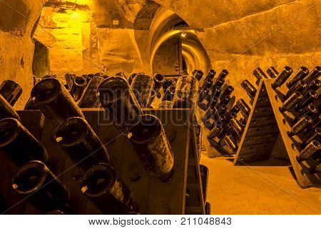 Reims France - June 12 2017: the caves of Champagne House Taittinger with old bottles Champagne in pupitres France.