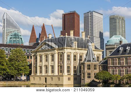 The Hague The Netherlands - August 6 2017: Museum 'Mauritshuis' skyscrapers and the 'Torentje' of prime minister of the Netherlands in front the pond 'the Hofvijver'.