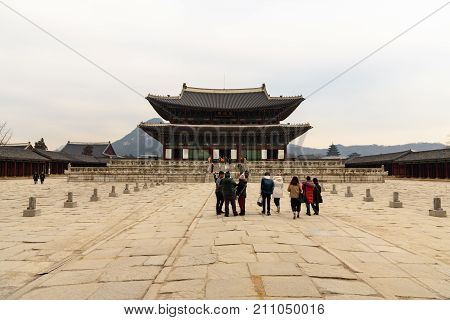 A Group Of Tourists Comes To Visit The The Temple Inside Gyeongbokgung Palace In Seoul.
