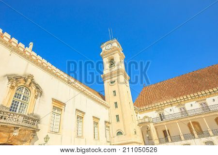 Popular and iconic University Clock Tower in blue sky. The University of Coimbra is the most ancient of Portugal and also one of the oldest in Europe.