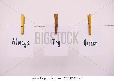 Inspirational Quotes - Always Try Harder On Handing Paper With Clothes Pin, Retro Style Background W