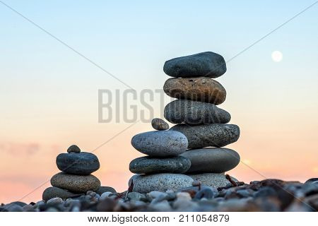 the three pyramids of stones stacked on top of each other the sea beach of the Black sea
