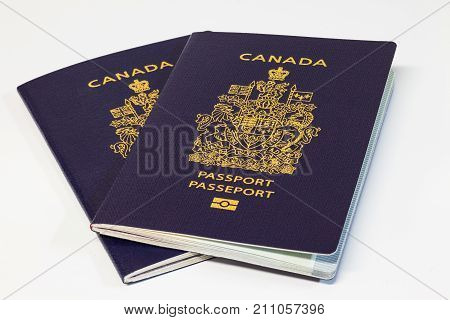Two new Canadian passports on white background