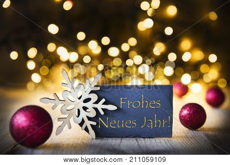 Plate With Golden German Text Frohes Neues Jahr Means Happy New Year. Bright Glowing Lights In The Background. Christmas Ornament Like Red Balls And Snowflake.
