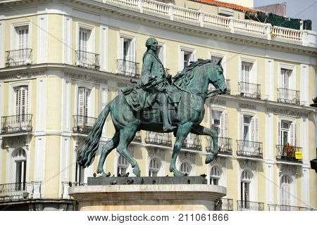Statue of Carlos III at Puerta del Sol Gateway of the Sun, Madrid, Spain. Carlos III Charles III was the King of Spain from 1759 to 1788.