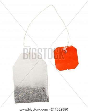 Teabag with red label isolated on a white