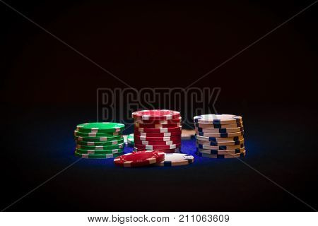 Stack of Poker chips on black background
