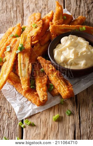 Delicious Appetizer Of Fried Baby Corn With Green Onion And Sauce Close-up. Vertical