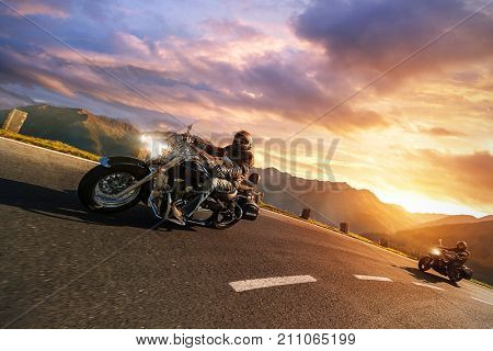 Motorcycle drivers riding in Alpine highway,  Hochalpenstrasse, Austria, Europe. Outdoor photography, mountain landscape. Travel and sport photography. Motorbikes designed and manufactured in Japan