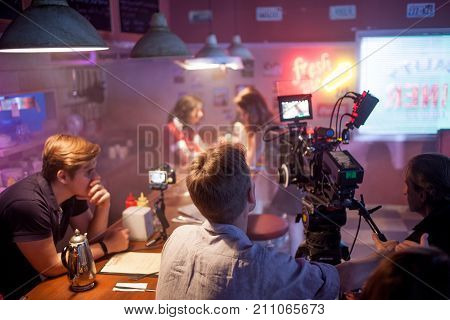 SAINT PETERSBURG, RUSSIA - JULY 22, 2017:Film Crew On Location. 4K Camera Cinematographer. Filmmaking. Set, scenery of the roadside cafe 80's style